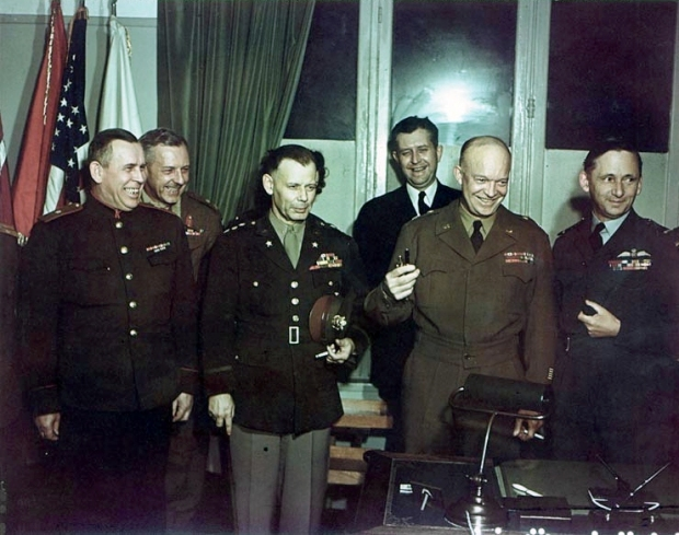 Soviet General Susloparov (far left) with General Eisenhower at Rheims surrender ceremony